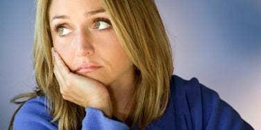 sad blonde woman wearing blue