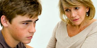 woman speaking to boy