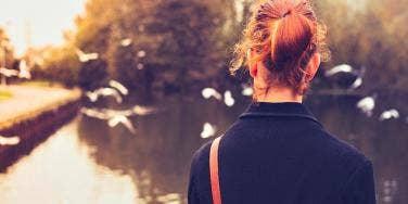 woman gazing at birds.