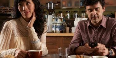 woman annoyed man phone dinner