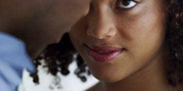 woman closely looking at man