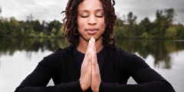 woman praying meditation