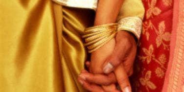 holding hands indian sari