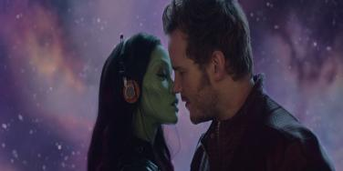 """Zoe Saldana as Gamora and Chris Pratt as Star Lord of the Marvel """"Guardians Of The Galaxy"""" movie, about to kiss and consummate their romance"""