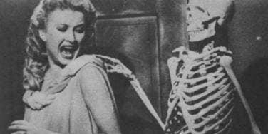 Skeleton touching woman
