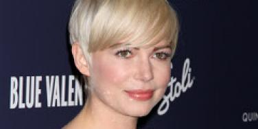 Michelle Williams poses on the red carpet.