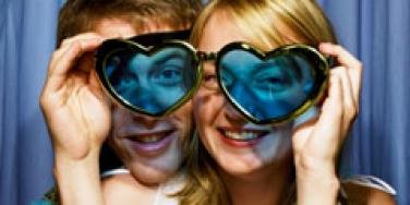 couple fooling around heart glasses