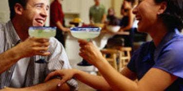couple sharing margaritas