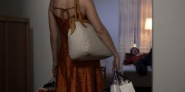 Woman coming home with shopping bags