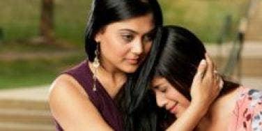 woman comforting crying woman