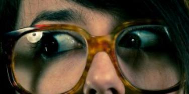 Woman wearing oversized glasses