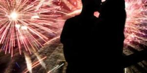 couple kissing with fireworks