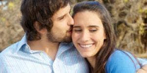 Happy couple kiss.