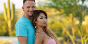 two contestants from 90 day Fiancé stand in a desert setting