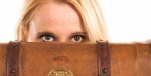 woman behind suitcase
