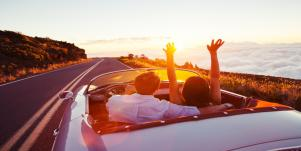 Couple driving on sunny road