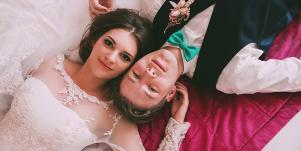 couple wedding laying down