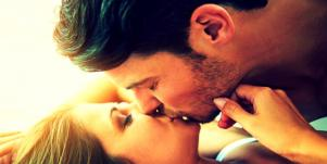 man and woman kissing laying down