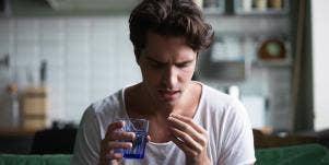 man taking a pill