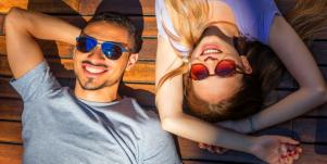 couple laying together wearing sunglasses