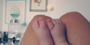 baby's feet on mom