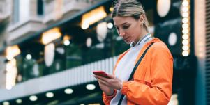 confident woman looking at her phone