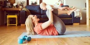woman working out at home with baby