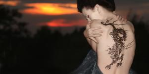 woman with dragon tattoo on her back