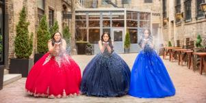 three girls wearing quince gowns