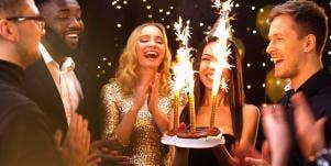 friends celebrating birthday with cake sparklers