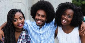 a group of black people smiling