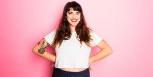 smiling woman in white shirt with pink background