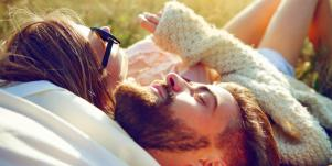 couple laying in the grass together