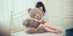 Girl hugging stuffed bear