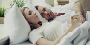 man and woman wearing white in bed