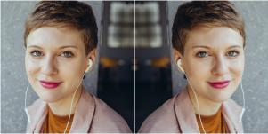 mirrored image of professional-looking woman wearing headphones