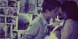 couple kissing cat