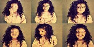 little girl in a photobooth