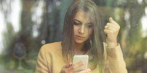 upset woman on her phone