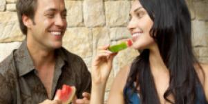happy couple eating watermelon smiling