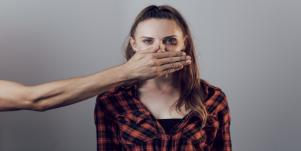 Man stopping woman from speaking