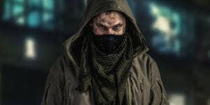 man wearing a black mask and green hood