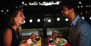 man and woman on nighttime date