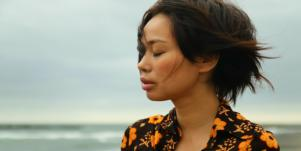 depressed woman on overcast beach