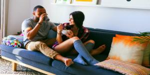 couple on couch laughing smiling