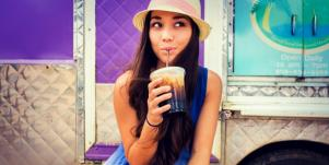 Woman sipping suggestively from a straw