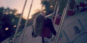 woman swinging at amusement park