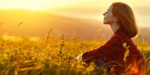 relaxed woman sitting on the field