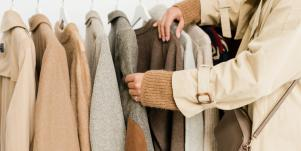 woman in trench coat shopping