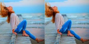 woman sitting on wooden pier throwing her head and hair back